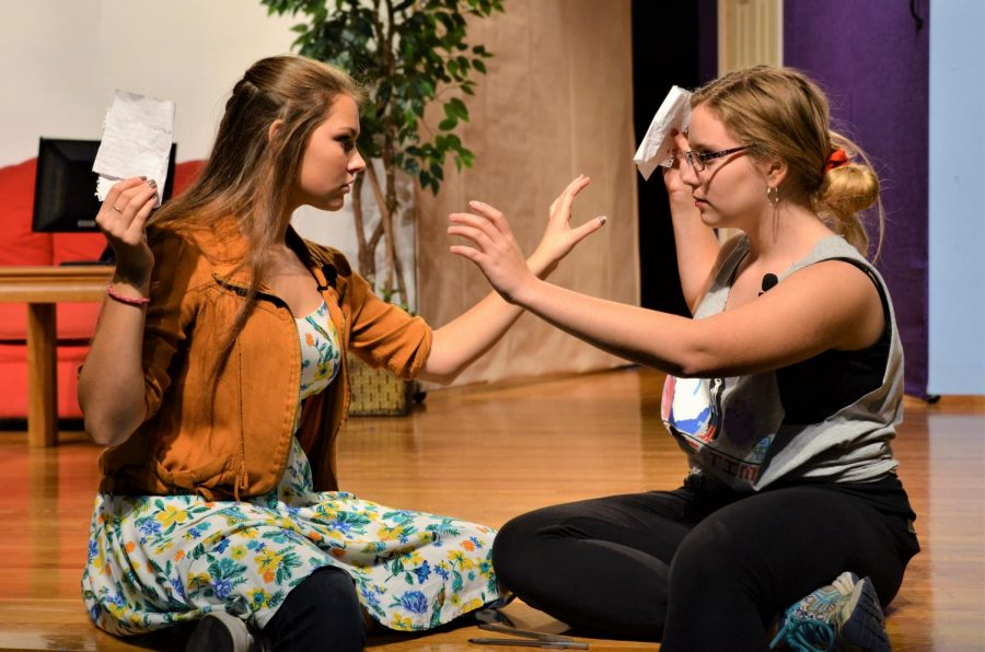 """Junior Annabel Bergeron (left) and freshman Claire Lord (right) rehearse their scene in """"Mutually Assured Destruction"""" about a pair of siblings in the year 2015."""