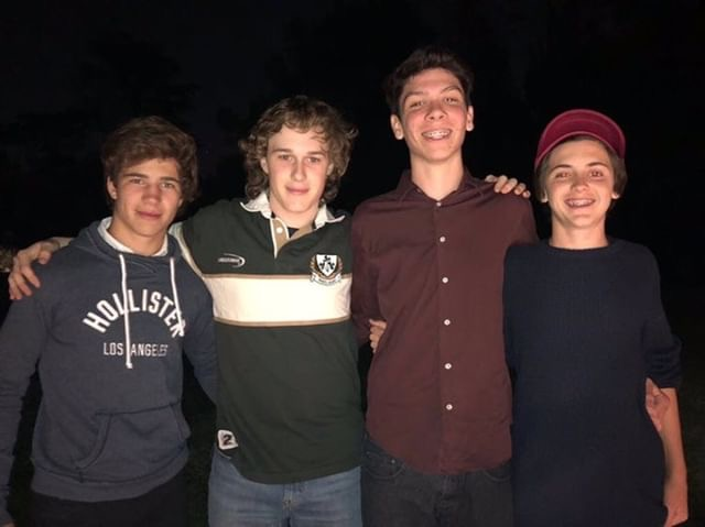 (Left to right: Santos Virasoro, Nicolas Bruno, Felipe Virasoro, Fran Gaing) The boys decide to take a break from dancing and celebrating Christmas to take a picture outside.