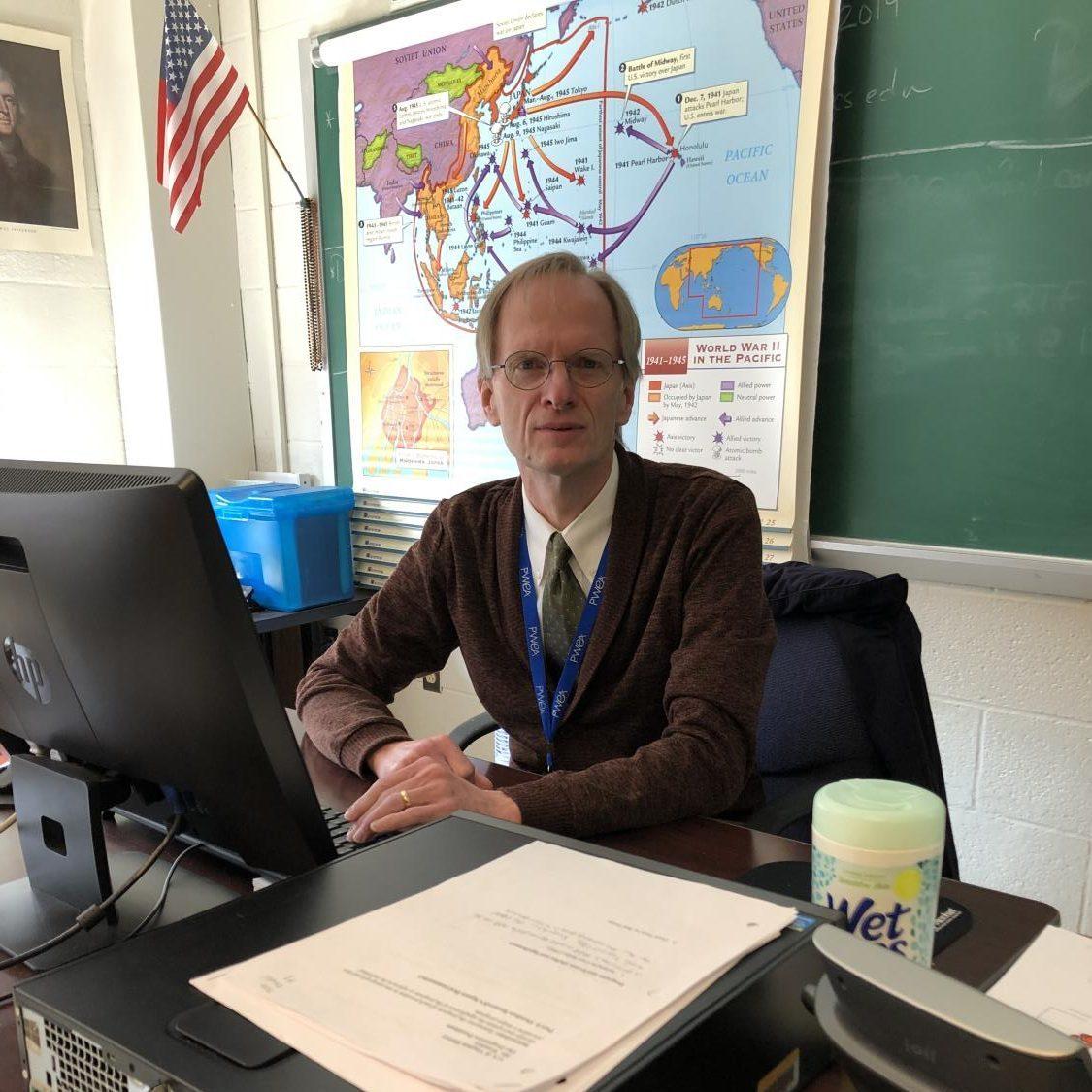 Mr. Wonders, one of BDHS' favorite teachers, sits at his desk.
