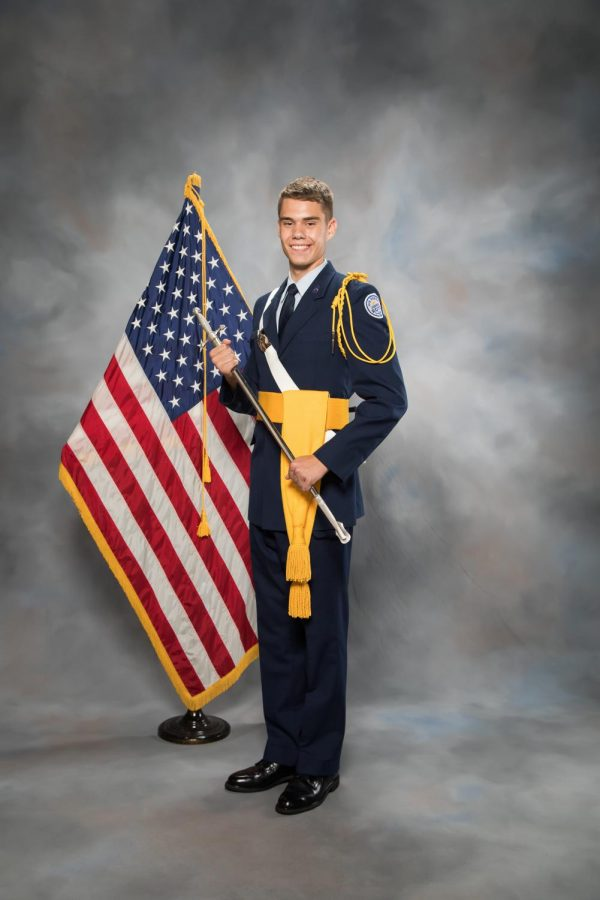 James Fees is posing in his Dress Blues.