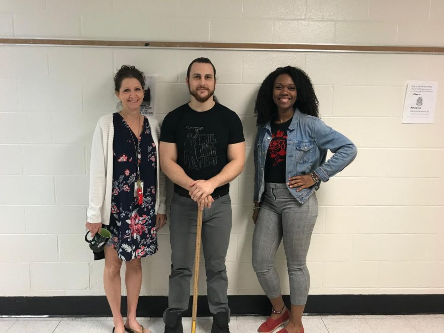 Ms. Neta Lowe (far left), Mr. Lucas Monson (middle), Ms. Jasmine Reed (far right) pose together in the foreign language hallway.