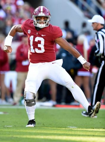 Tua Tagovailoa (13) celebrates his third touchdown of the game.