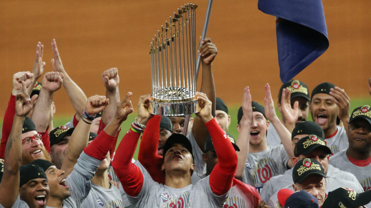 Juan Soto holding the world series trophy