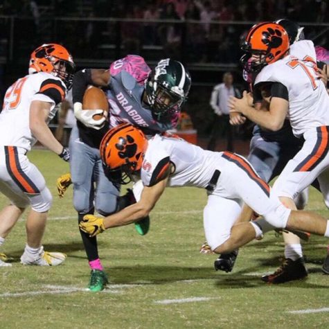 Kyler Cornwell (5) tackles a William Monroe player.