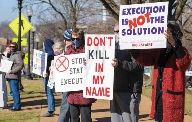 People gathered on Tuesday Jan. 12, 2021 protesting the death penalty and the impending executions of federal inmates; Lisa Montgomery, Corey Johnson and Dustin Higgs.