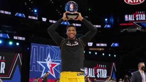Giannis holding Kobe Bryant MVP trophy